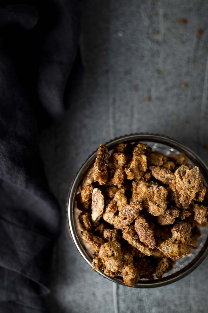 candied pecans in a glass dish