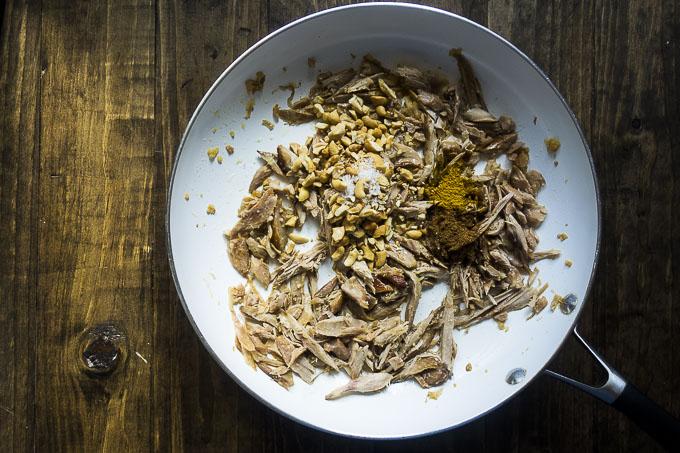 shredded turkey and seasonings in a skillet