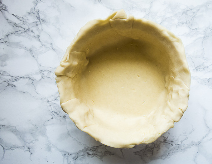 empty pie crust in a baking dish