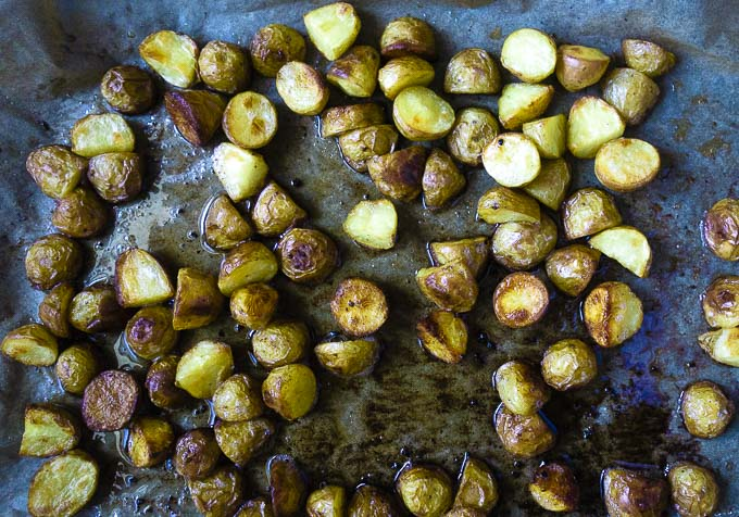 crispy roasted potatoes on a baking sheet