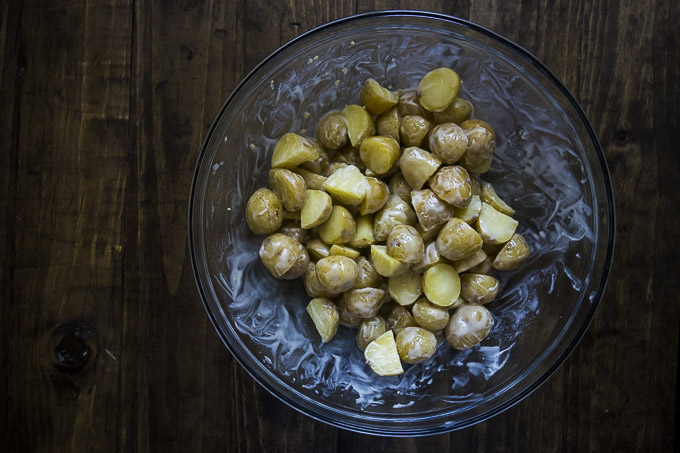 bowl of potatoes covered in butter
