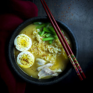 instant pot ramen in a bowl with leftover turkey and chopsticks