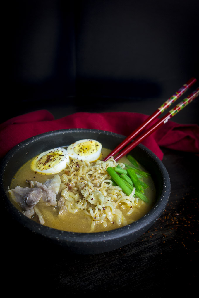 bowl of instant pot ramen with chopsticks and eggs