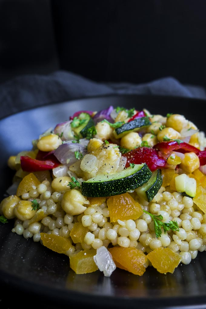 side view of bowl of couscous salad with chickpeas