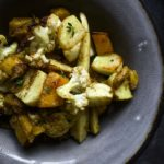 bowl of roasted winter vegetables garnished with thyme