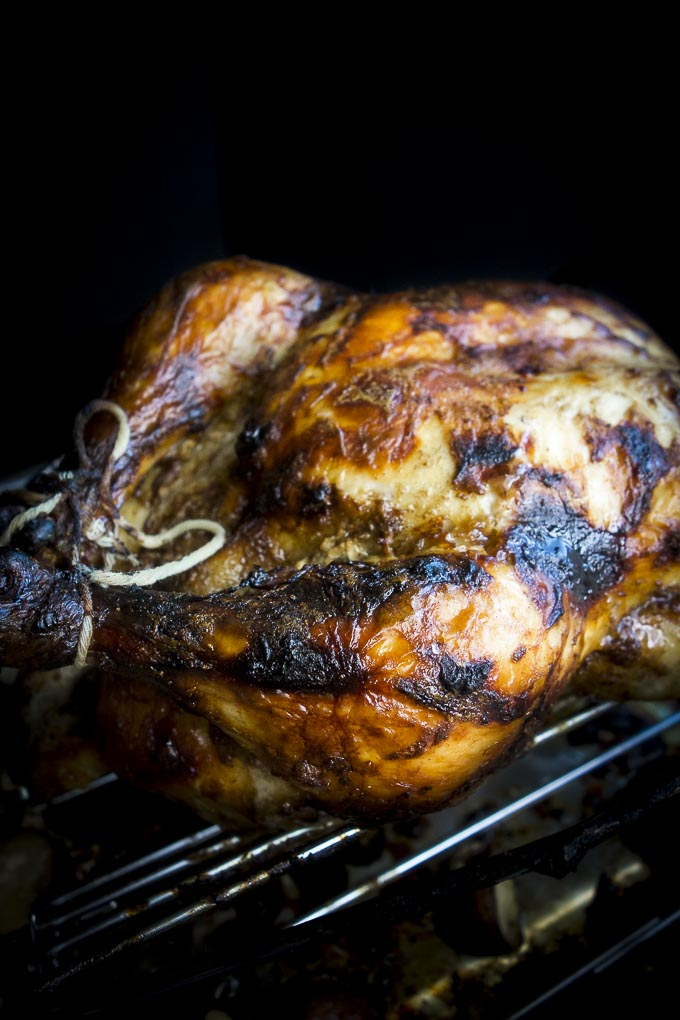 indian spiced roasted chicken on a roasting rack