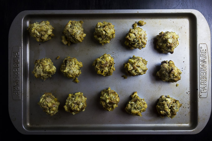 stuffing balls on a baking sheet