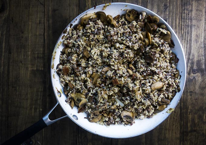 wild rice and mushroom stuffing in a skillet