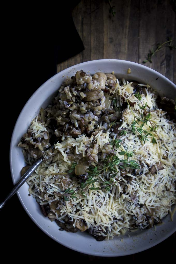 wild rice stuffing with mushrooms covered in parmesan cheese