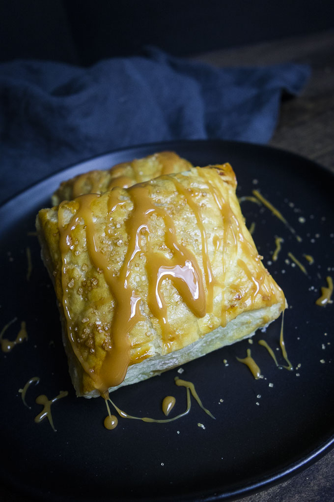 puff pastry apple turnover drizzled with caramel close up