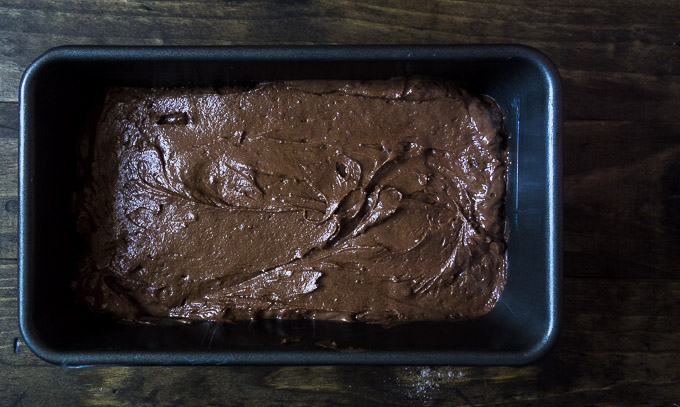 chocolate orange bread batter in a loaf pan