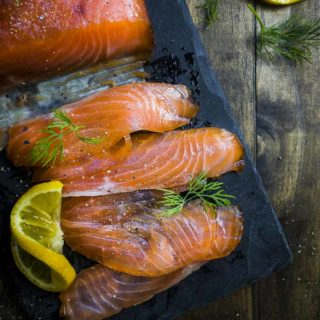sliced cured salmon with lemon slice and dill