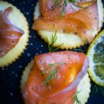 cured salmon on crackers with dill and pepper