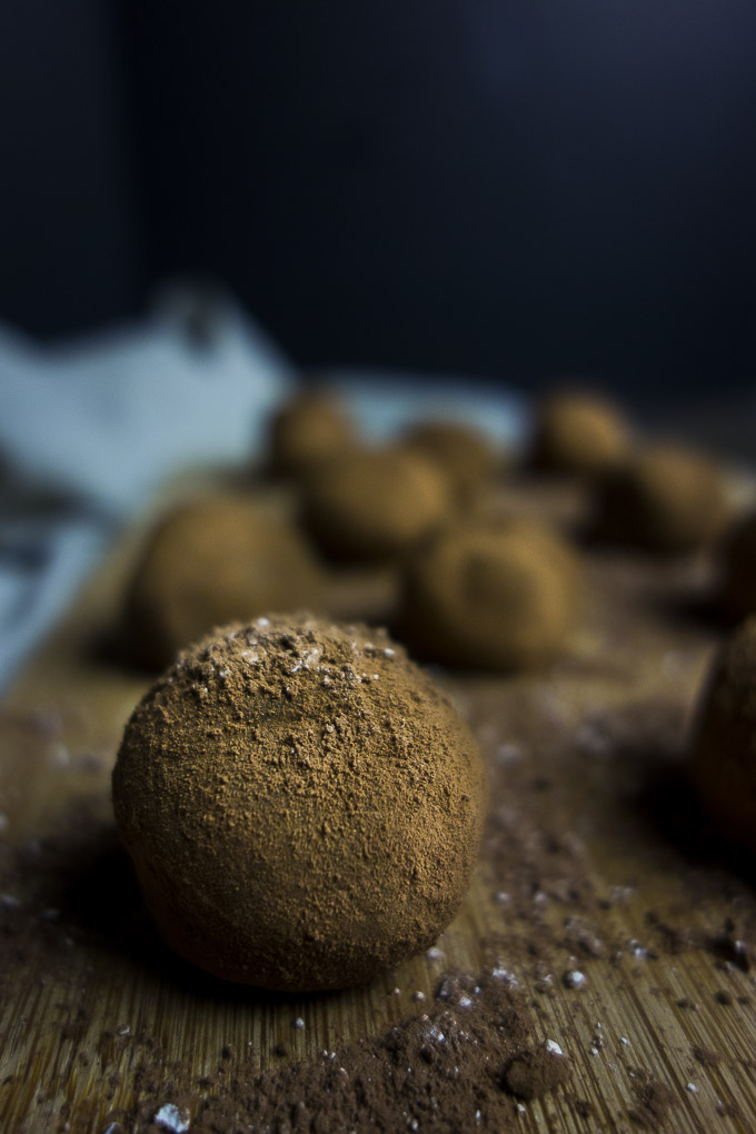 dark chocolate truffles on a board-food photography