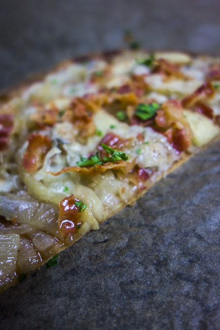 slice of caramelized onion flatbread pizza