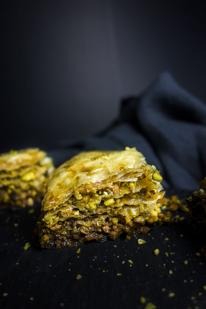 side view of slice of pistachio baklava