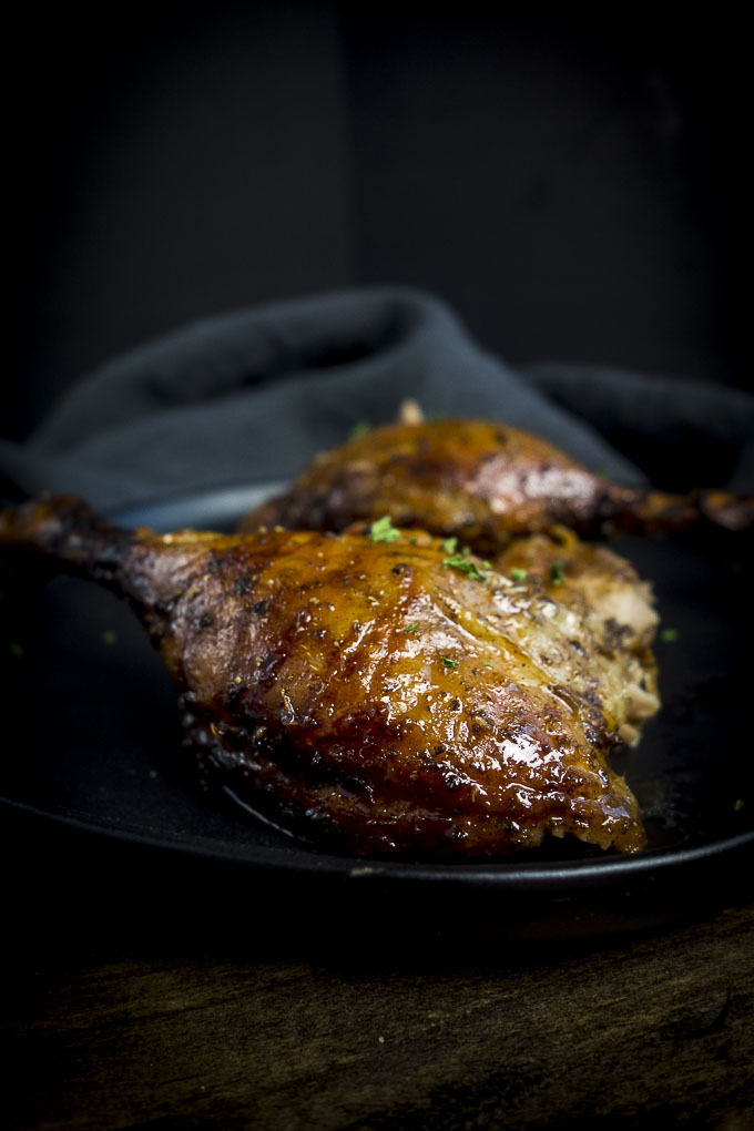 crspy roasted duck on a plate with orange glaze