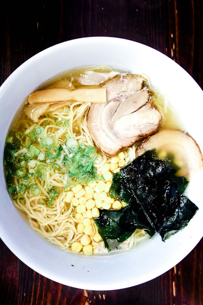 bowl of ramen with pork and seaweed