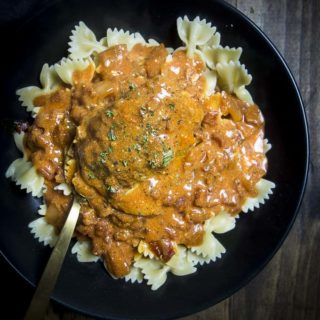 hungarian chicken paprikash in a bowl with a spoon