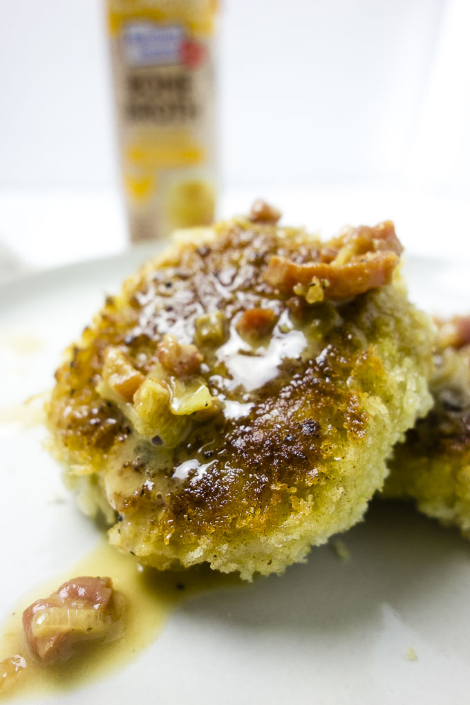 close up photo of risotto cake with gravy on top