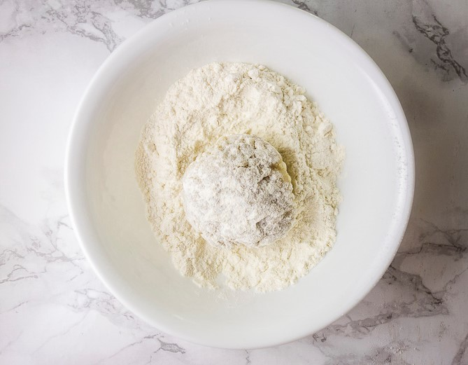 ball of risotto coated in flour