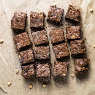 sliced brownies dusted with powdered sugar on paper