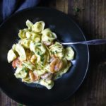 shrimp and tortellini in a bowl with creamy sauce