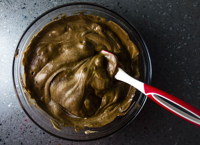 fluffy chocolate batter in a bowl with a spatula