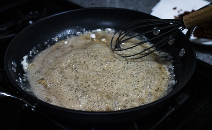 roux being whisked in a skillet
