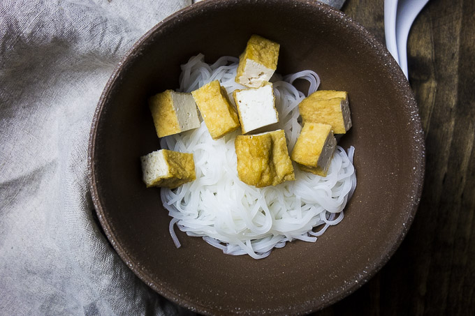 bowl of plain rice noodles and fried tofu