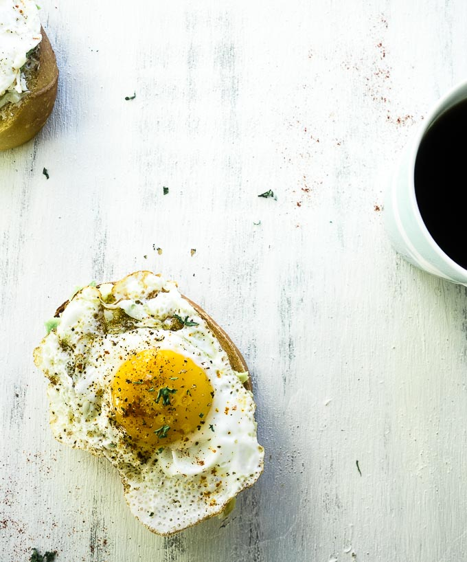 fried egg on bread with a cup of coffee