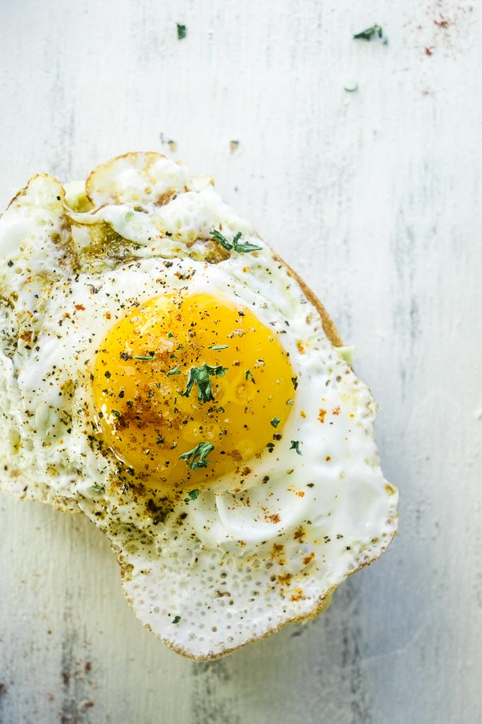 fried egg on top of a piece of bread