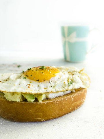 bread with avocado and a fried egg on top