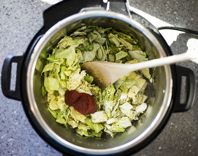 cabbage and tomato paste in a pot