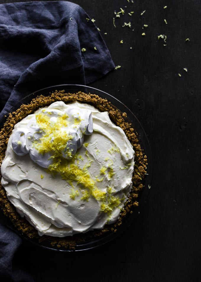 lemon pie with whipped cream and lemon zest on top