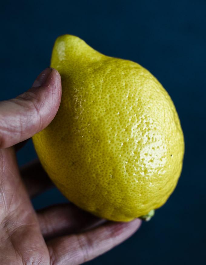 hand holding a lemon