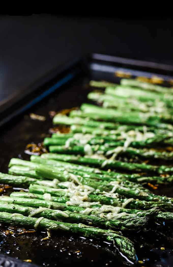 baking sheet of roasted asparagus stalks