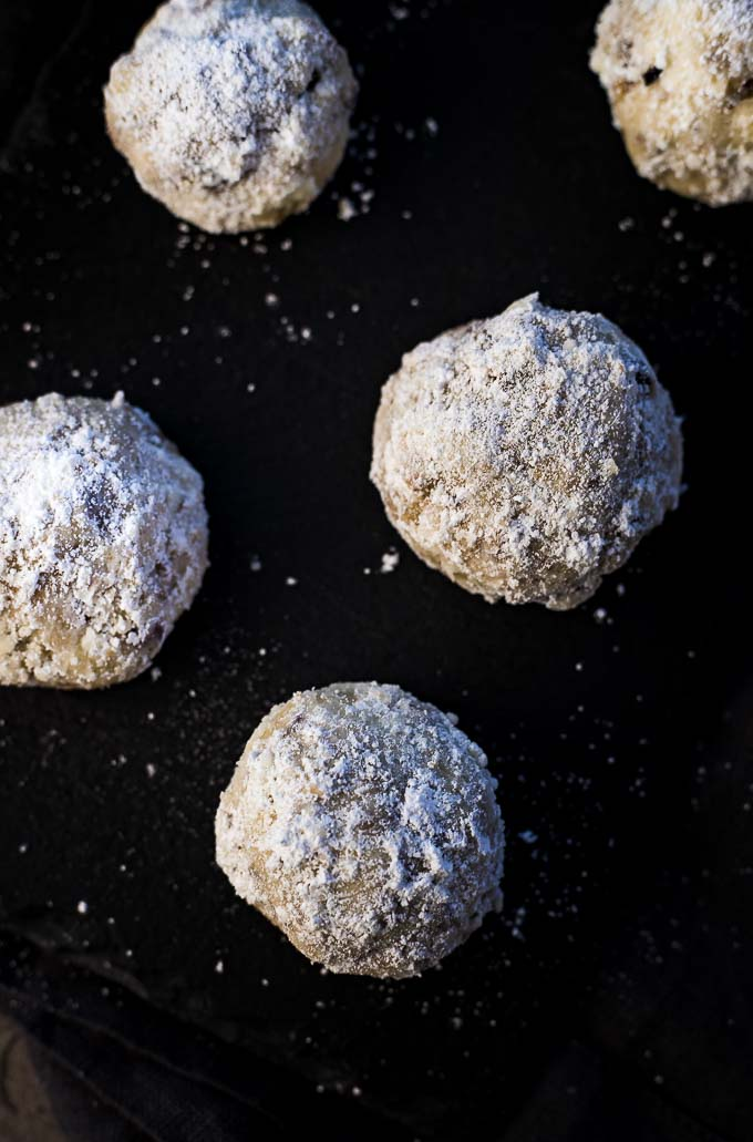 powdered sugar coated cookies on a plate