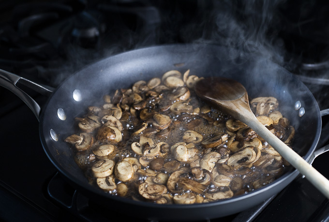 mushrooms being cooked in broth