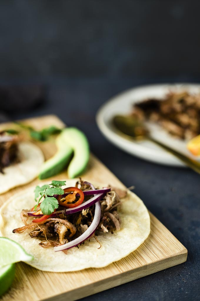 shredded pork and vegetables on a tortilla