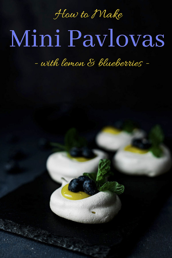 Sweet, tangy lemon curd and fresh blueberries on top of light and crispy meringue shells, this mini pavlova recipe is incredibly easy to make! Impress your friends and family at your next gathering with these delicious lemon and blueberry topped mini pavlovas - they are sure to be a hit! The perfect spring recipe, mini pavlovas with berries and lemon curd and wonderfully fresh, light and just so damn delicious! #wenthere8this #pavlovacake #minipavlova