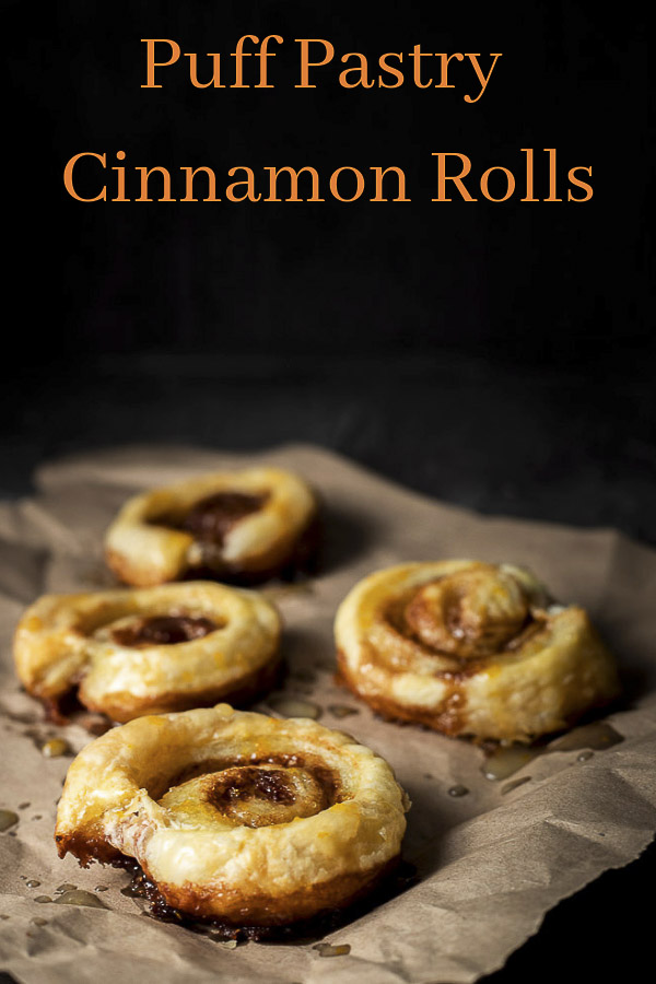 These puff pastry Cinnamon Swirls are baked to a buttery, flaky, gooey caramelized perfection, then drizzled with an orange glaze, all  done in under 30 minutes! You\'re going to fall in love with these puff pastry cinnamon rolls. They have no yeast so you don\'t have to spend time waiting for them to rise. These easy cinnamon rolls are the ultimate brunch treat! #wenthere8this #cinnamonswirls #cinnamonbunday