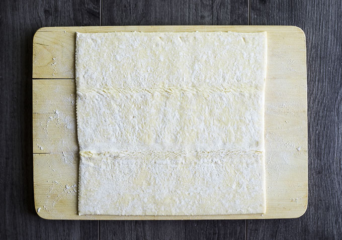 puff pastry sheet on a floured cutting board
