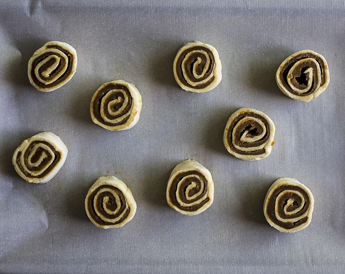raw cinnamon swirls on parchment paper
