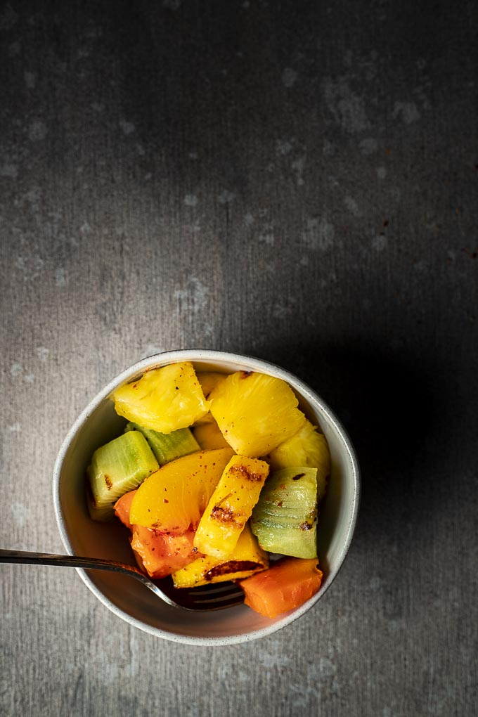 bowl of fruit with chili vinaigrette