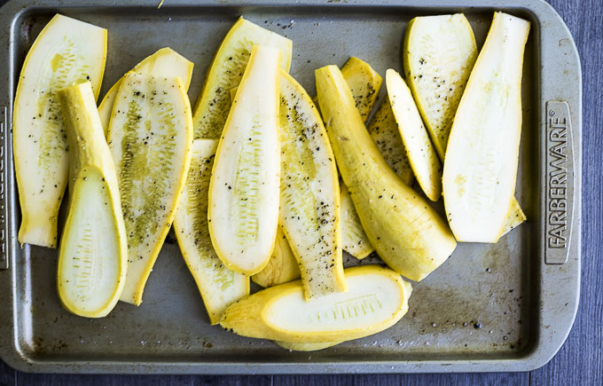 sliced yellow squash on a baking sheet
