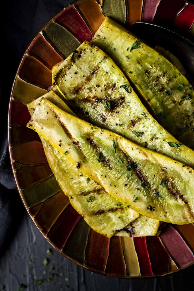 grilled squash on a colorful platter