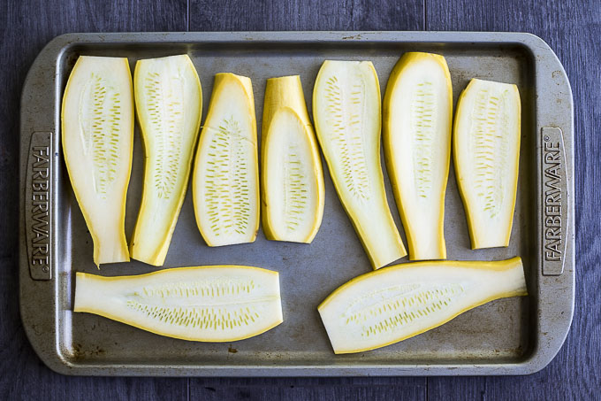 slices of yellow squash laid out on a baking sheet