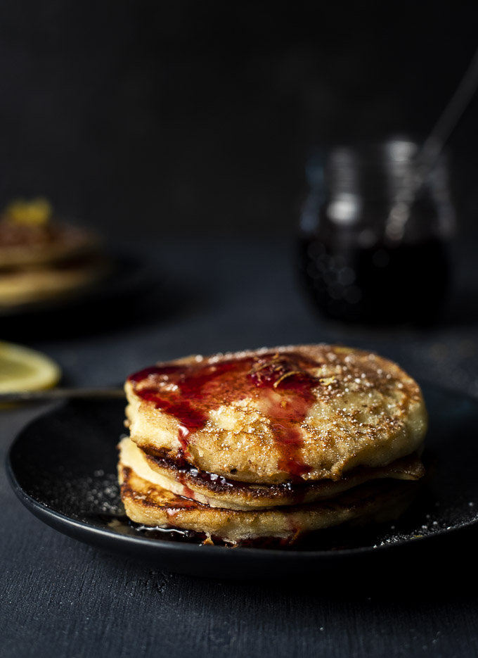 plate of pancakes topped with cherry syrup