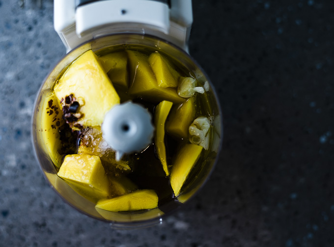 chunks of mango and chili in a food processor
